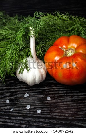 Fresh ripe vegetables on a black table or board like background. - stock photo
