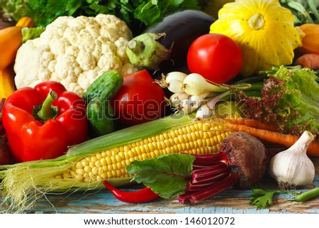 Fresh ripe vegetables on a wooden board. - stock photo
