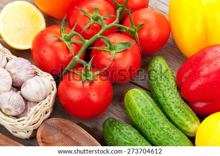 Fresh ripe vegetables on wooden table - stock photo