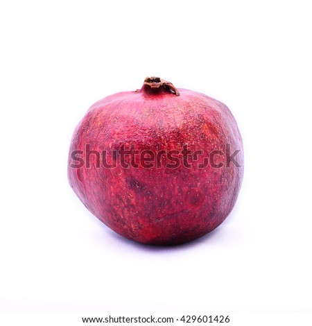 Fresh ripe whole pomegranate. Isolated on white background. Selective focus - stock photo