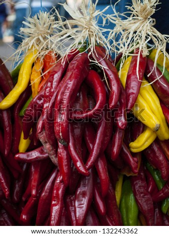 Fresh rista on display at the local farmers market. Legend has it, in the Southwest, that hanging chili ristras brings good luck if hung at the entrance of the home. - stock photo
