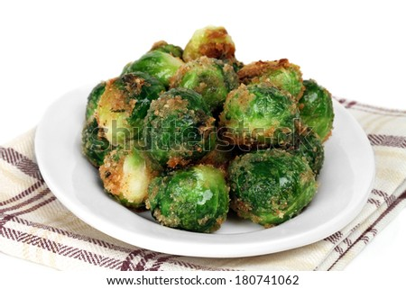 Fresh roasted brussel sprouts.  Macro image with a white background for copy space. - stock photo