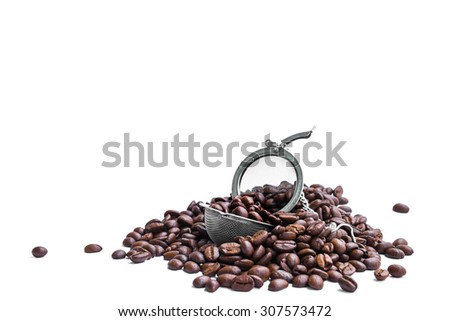 Fresh roasted coffee beans with strainer - stock photo