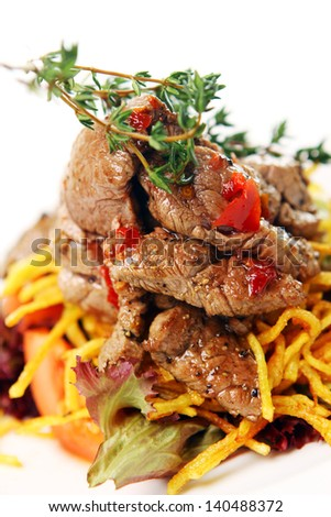 Fresh roasted meat on a pillow from noodles and vegetables