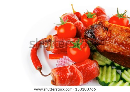 fresh roasted meat rolls and chunk on white platter - stock photo