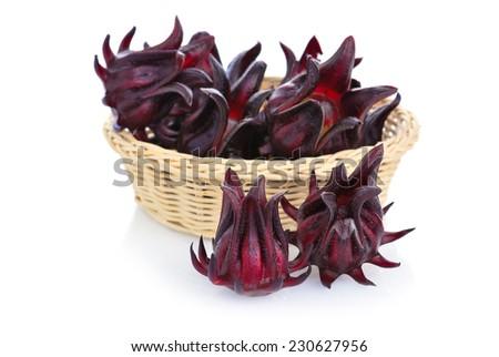 Fresh roselle fruits or Hibiscus sabdariffa on white background - stock photo