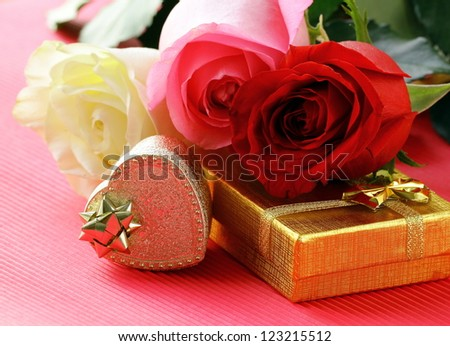 fresh roses and gifts for the holiday Valentines Day - stock photo