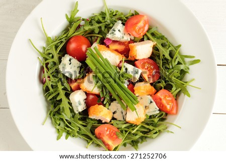 Fresh rucola, tomato, chive and mildew cheese with chicken  - stock photo