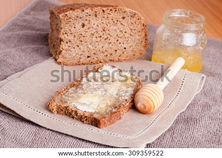 Fresh rye bread, butter and honey