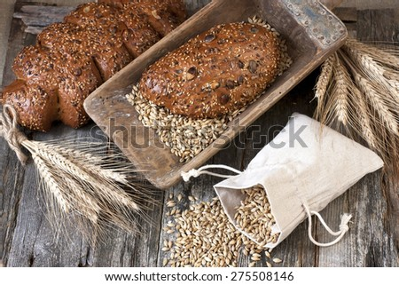 Fresh rye loaf of bread , rustic style - stock photo