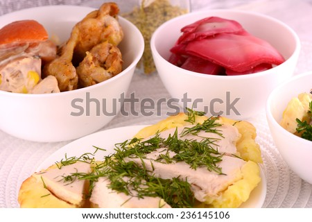 fresh salad and chicken chop on white plate - stock photo