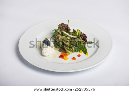 Fresh salad and ricotta with bue caviar - stock photo