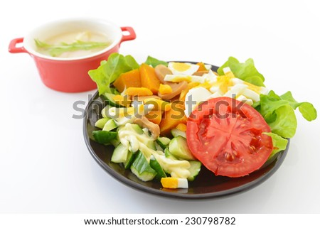 Fresh salad and soup - stock photo