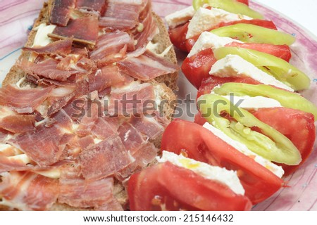 Fresh salad from vegetables, cheese and ham