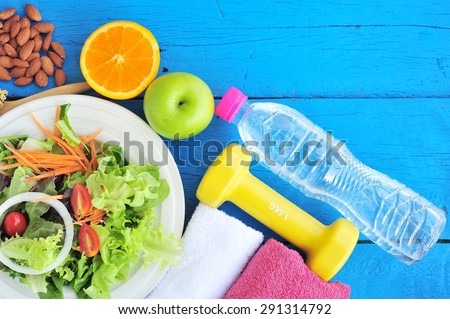 Fresh salad, fruits with sport and diet concept. - stock photo