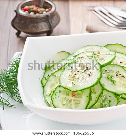 Fresh salad of cucumbers with dill and pepper - stock photo