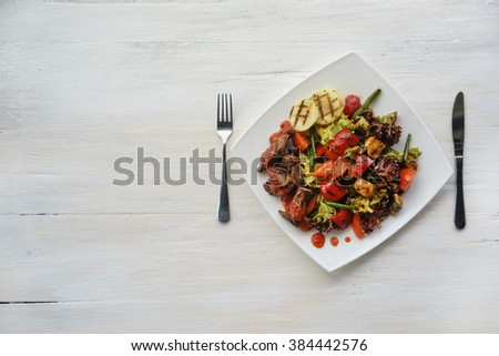 fresh salad of veal cooked delicious with grilled vegetables on white plate - stock photo