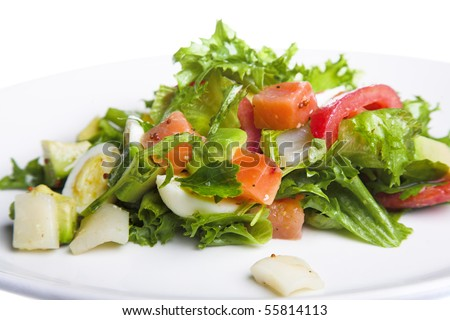 fresh salad on white plate isolated
