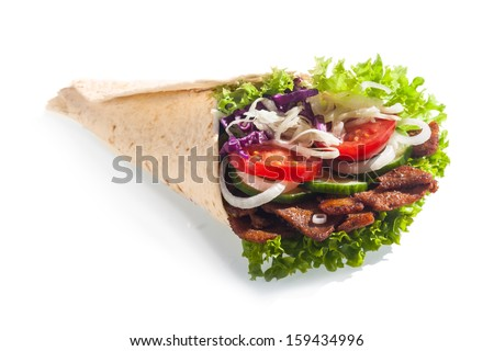 Fresh salad taco or tortilla wrap or doner with healthy lettuce, tomato, onion, cucumber and meat served for a quick takeaway snack at a restaurant, on a white background - stock photo