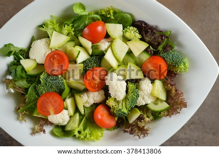 Fresh salad with cherry tomatoes and cucumber slices