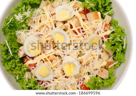 Fresh salad with chicken breast, cheese and eggs  isolated over white background - stock photo