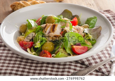 Fresh Salad with chicken breast on  white plate. Selective focus