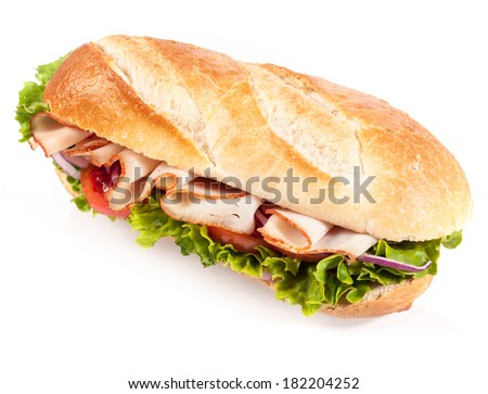Fresh salad with chicken on a crusty golden French baguette for a healthy snack or meal, closeup angled view on white - stock photo