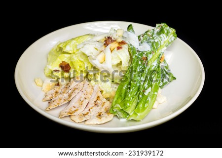 Fresh salad with chicken on the plate - stock photo