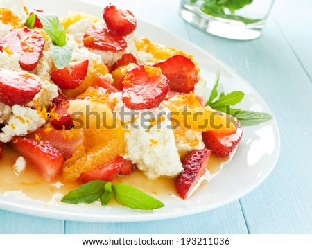 Fresh salad with fruits, berries and cottage cheese. Shallow dof. - stock photo