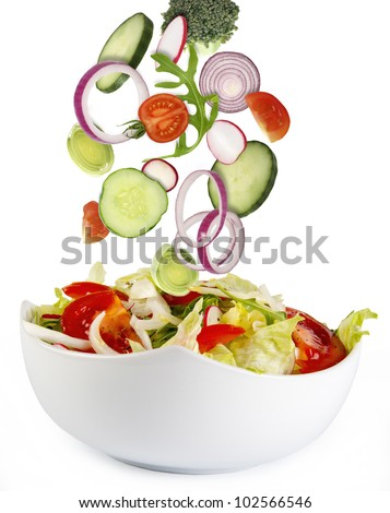 Fresh salad with ingredients - stock photo