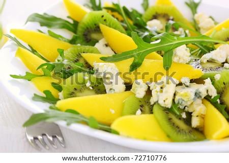 Fresh salad with mango, kiwi and blue cheese - stock photo
