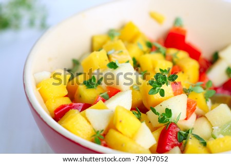 Fresh salad with mango, red pepper, apple and lemon thyme - stock photo