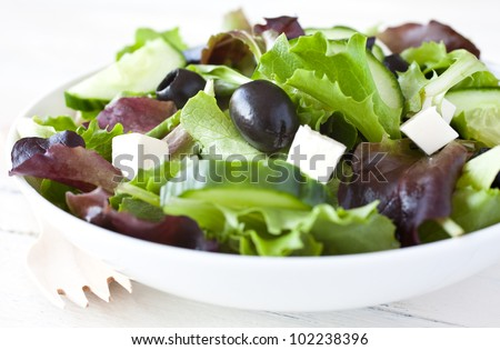 fresh salad with olives and feta cheese - stock photo