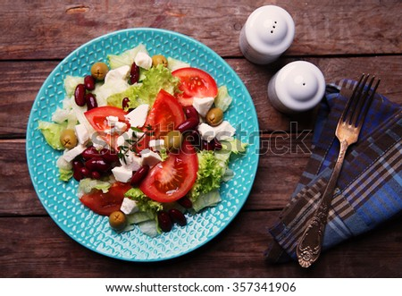 fresh salad with red bean on blue rustic plate - stock photo