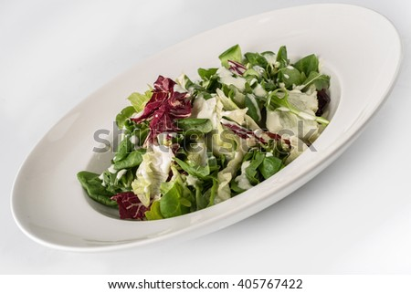 Fresh salad with red cabbage and yogurt