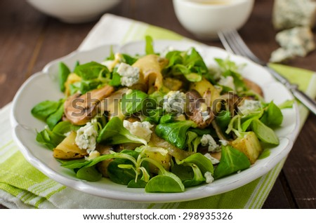Fresh salad with roasted potatoes, mushrooms and lamb lettuce salad with mustard dip and blue cheese