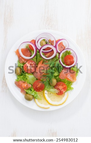 fresh salad with salted salmon, top view, vertical, close-up - stock photo
