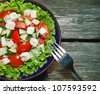 fresh salad with tomato and cucumber. green salad, tomato - stock photo