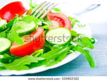 Fresh salad with tomatoes, rucola and cucumbers