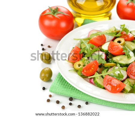 Fresh salad with vegetables and arugula on a white background