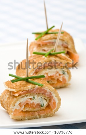 Fresh salmon and cream cheese canapes with chives - stock photo