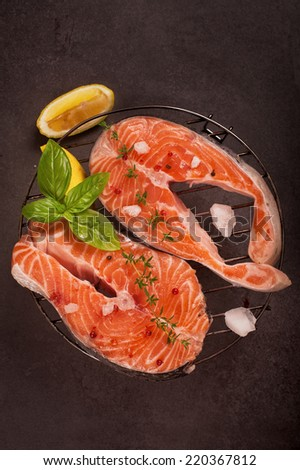 fresh salmon and ingredients for cooking on a pan,  - stock photo