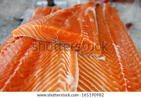 Fresh salmon at the fish market - stock photo