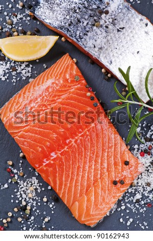 fresh salmon filet on a slate plate - stock photo