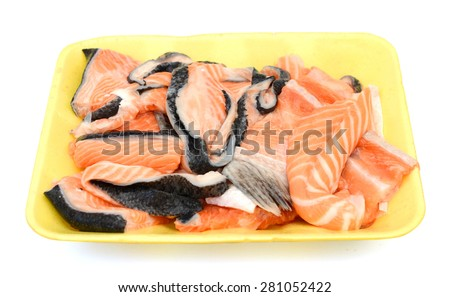 fresh salmon fillet in tray on white background