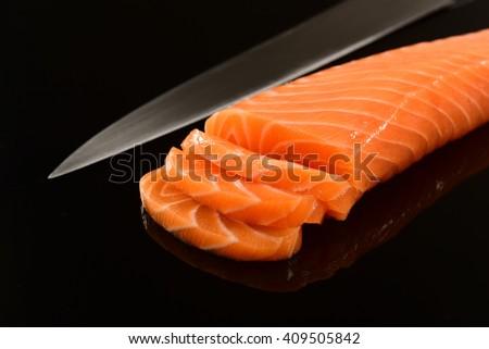 Fresh Salmon fillet on black background - stock photo