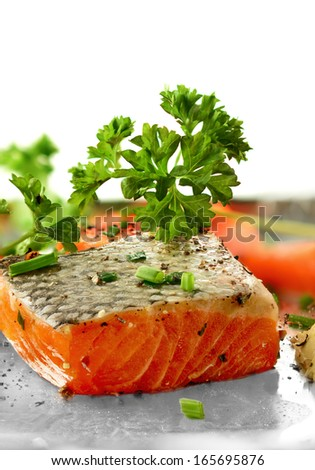 Fresh salmon fillet with garnish and cracked black pepper. Copy space. - stock photo