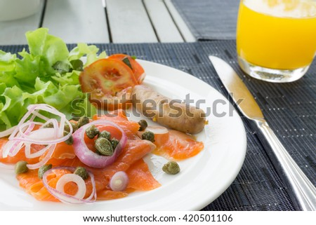 Fresh salmon salad with orange juices. Breakfast meal. Healthy food. - stock photo