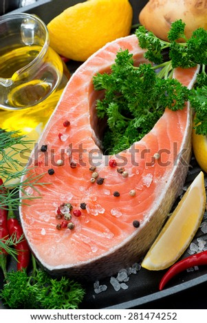 fresh salmon steak and ingredients for cooking, close-up, top view, vertical - stock photo