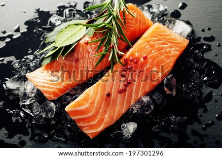 Fresh salmon with herbs and spices  - healthy food, diet and cooking concept - stock photo